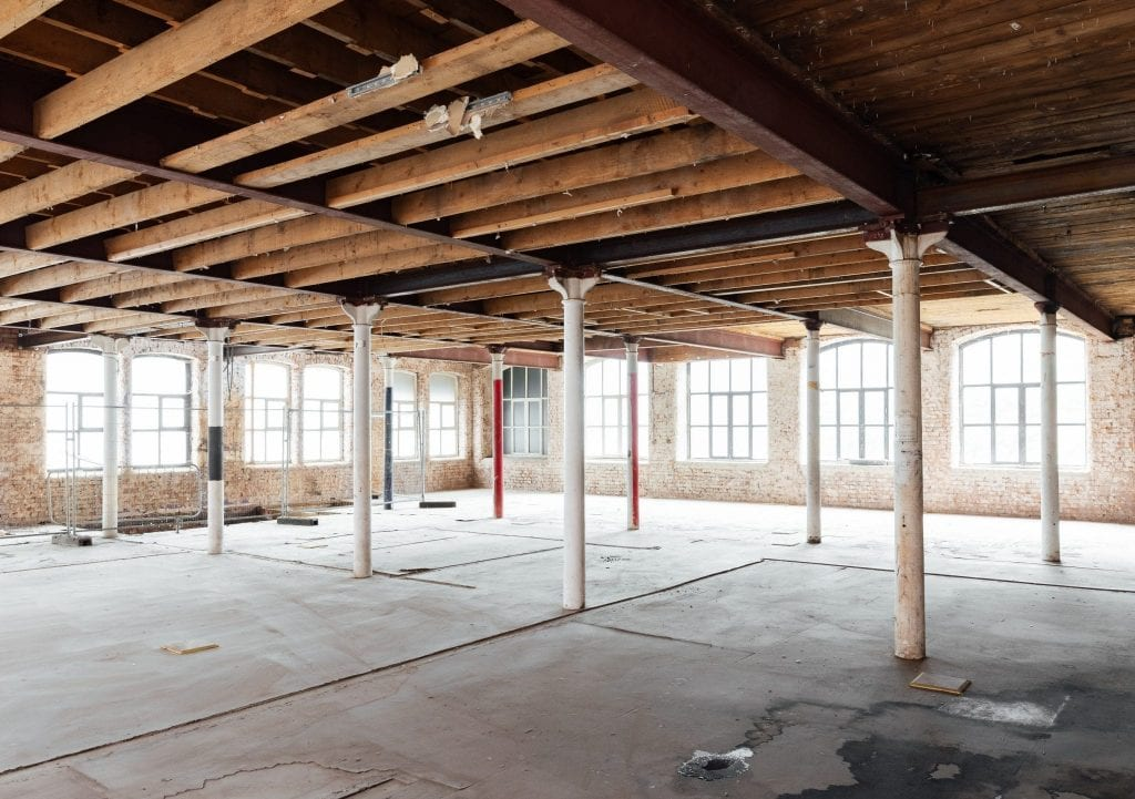 Old columns and exposed beams during build project at forthcoming apartment hotel at Cotton Yard Manchester