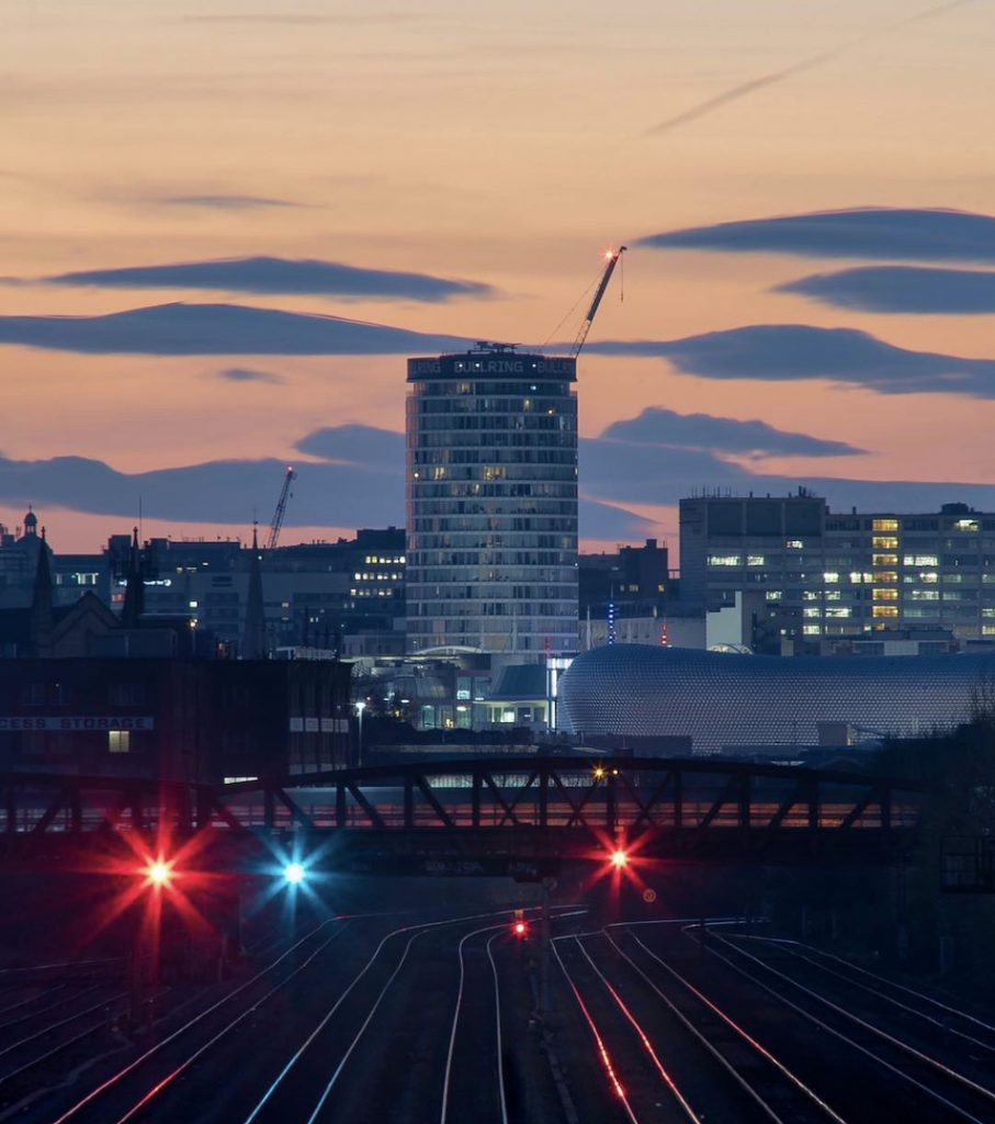 Staying Cool's apart hotel at rotunda viewed from distant trainlines at dusk, taken by photographer Martin O'Callaghan (@OCUK)
