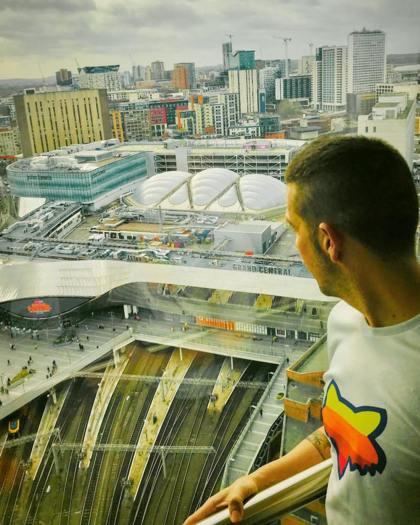 A picture of a guest looking out from his apartment over Birmingham in the daytime