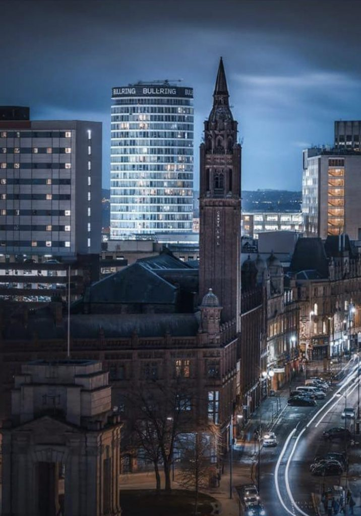 Night time city view featuring Staying Cool's aparthotel at Rotunda taken by photographer Verity Milligan