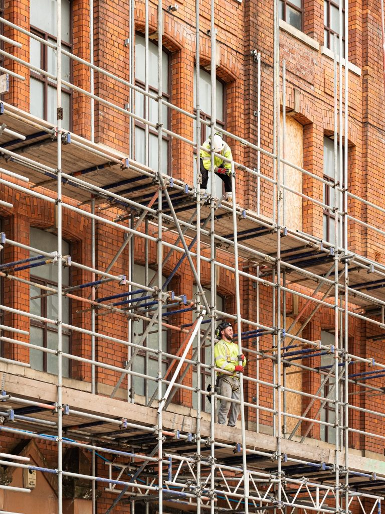 Builders and scaffolding at Cotton Yard Manchester