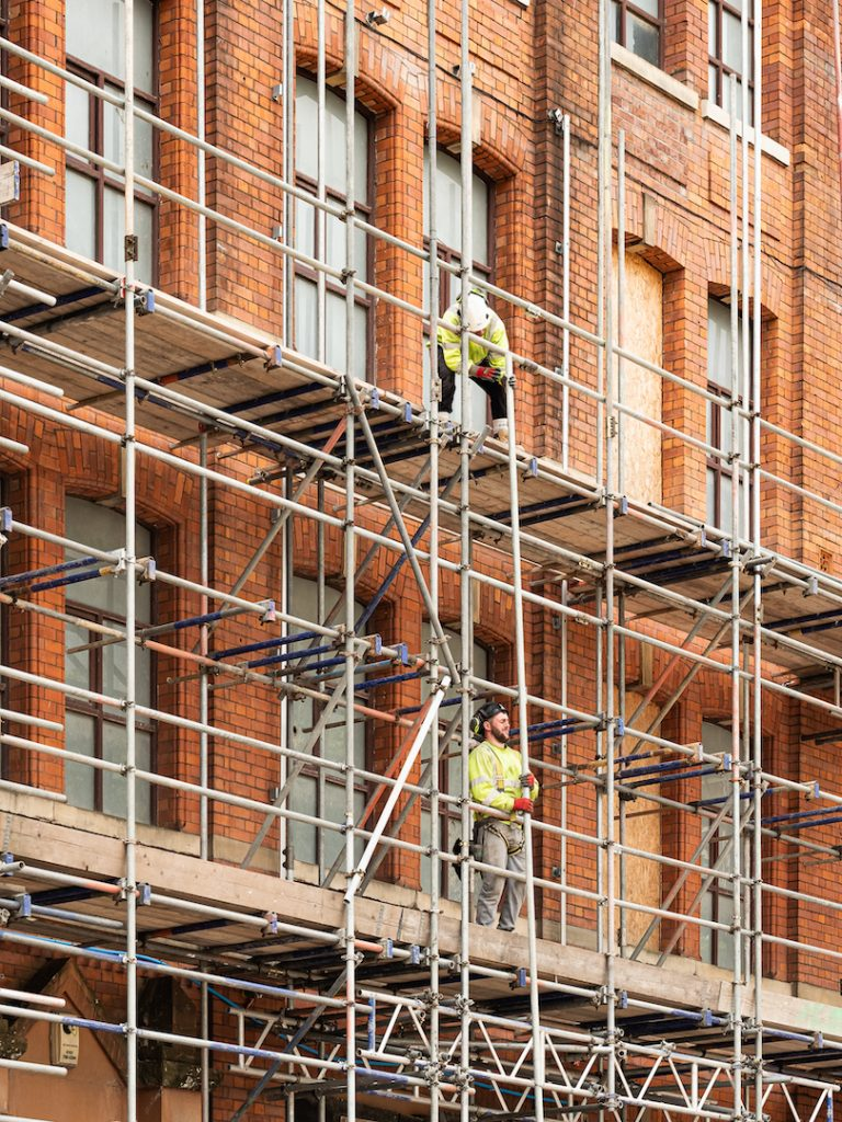 Builders-working-on-scaffolding-outside-Cotton-Yard-72px
