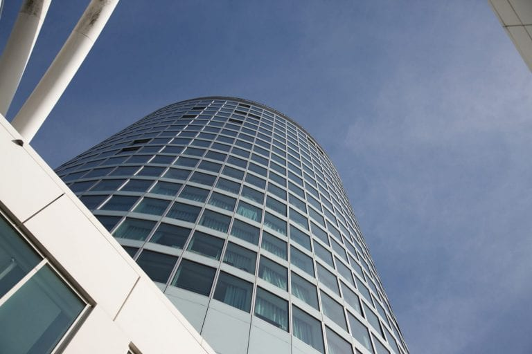 Rotunda serviced apartments Birmingham exterior shot looking up from the ground to the top