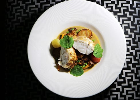 Opus Monkfish Dish on a white plate