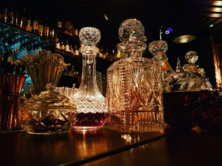 Bourne and Co inside of the bar showing classic spirit bottles and decanters