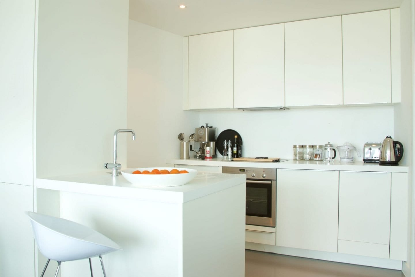 White Poggenpohl kitchen at Staying Cool's family friendly serviced apartments Birmingham