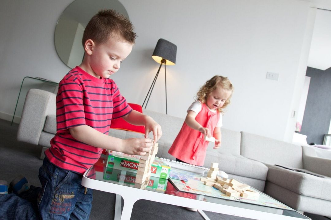Little kids playing with Jenga at Staying Cool's family friendly serviced apartments Birmingham