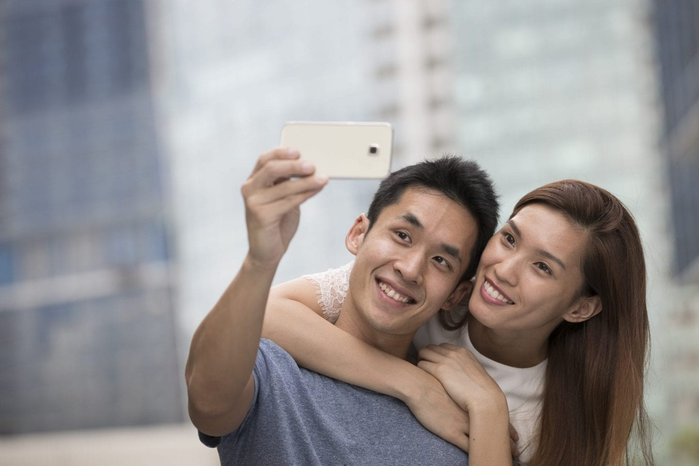 Chinese couple taking a selfie