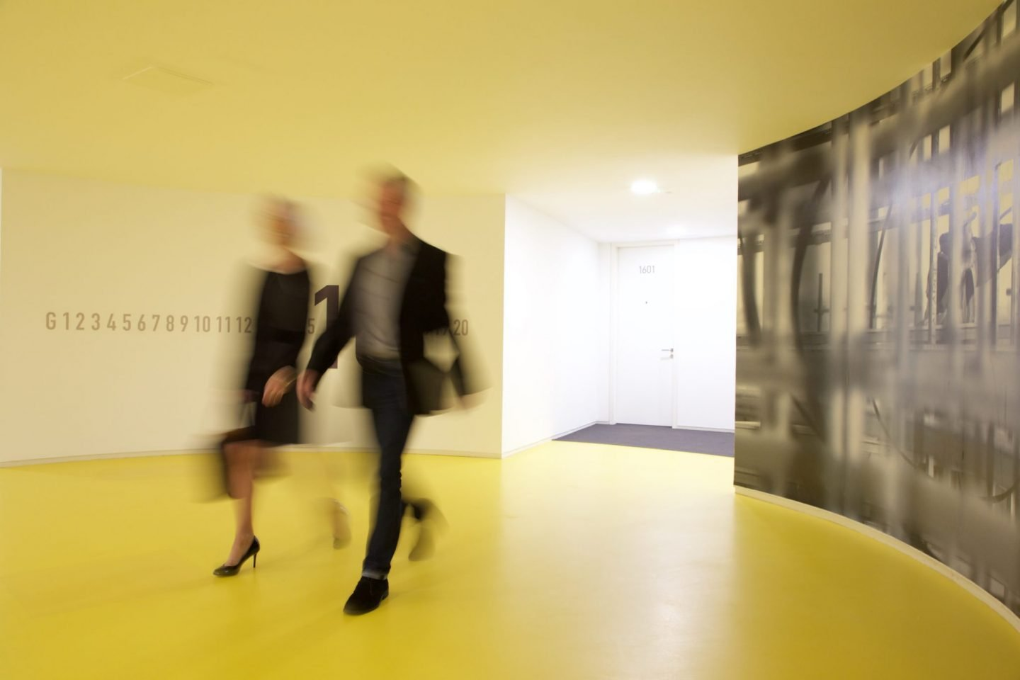 two corporate guests leaving their apartment