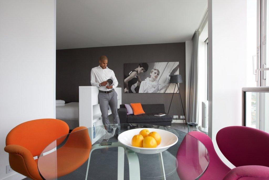 Man reading magazine in studio apartment. romantic break birmingham blog