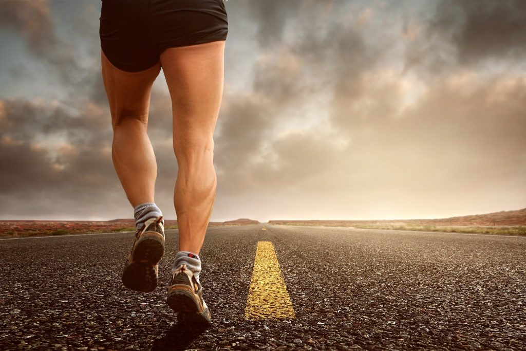 Image of person running down an empty road