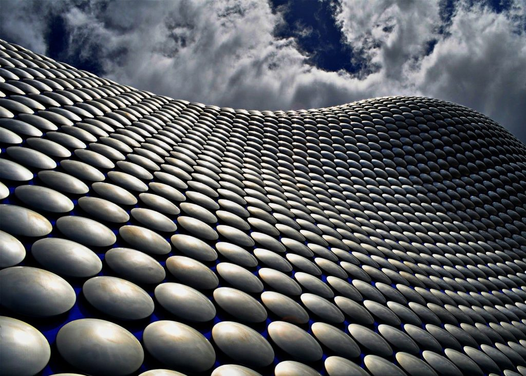 Exterior of Selfridges Birmingham showing curve of building and some of the 15,000 aluminium disks that clad the building.