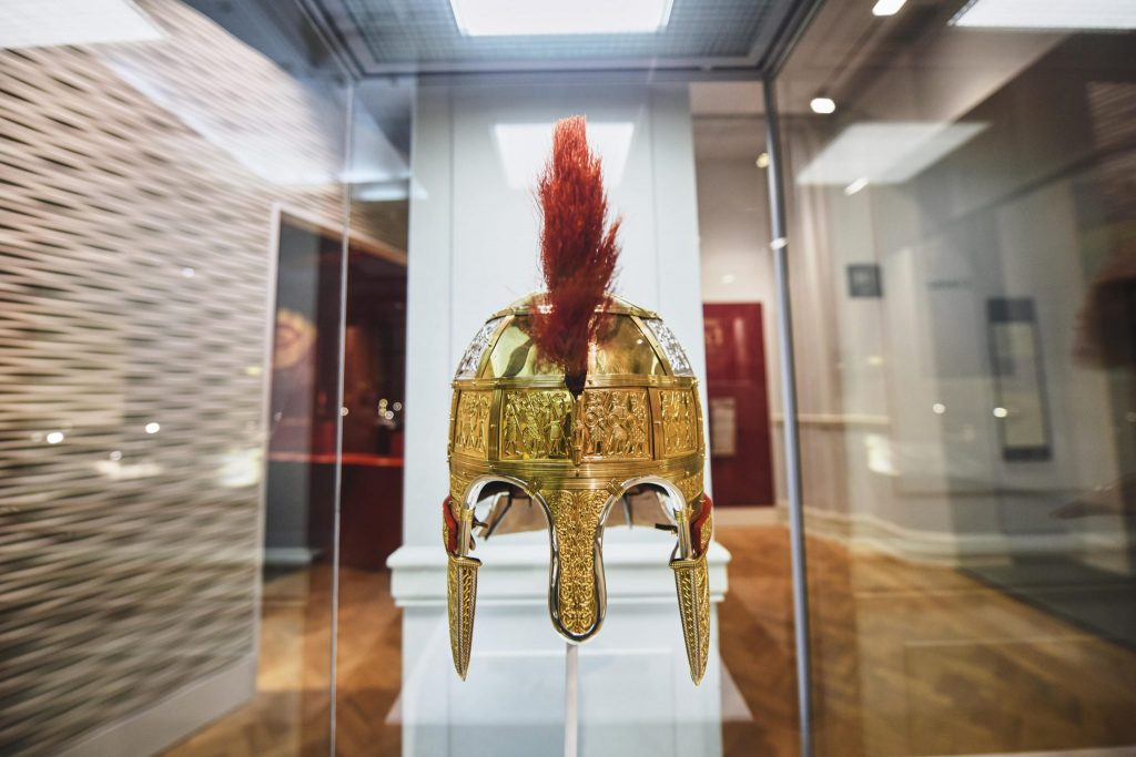 Gleaming helmet in glass case at BMAG, Birmingham. Part of the Staffordshire Hoard