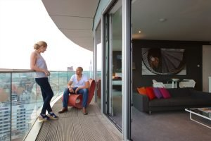 Couple relaxing on penthouse balcony