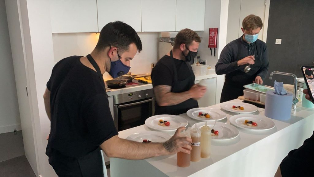 Wilderness chefs prepping dishes in penthouse