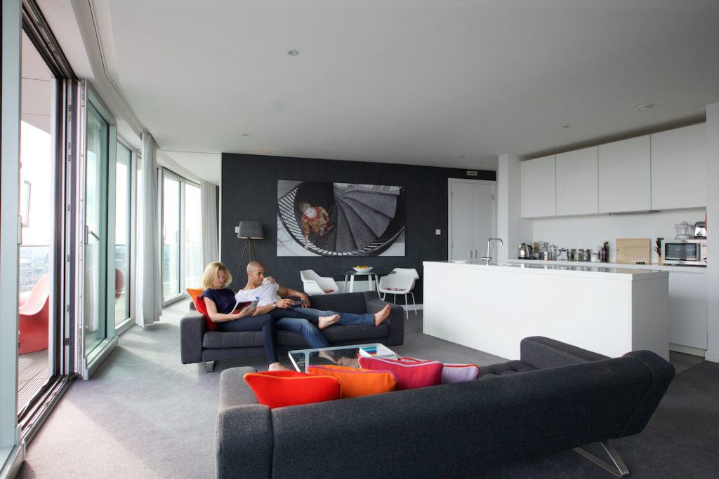 Couple relaxing on sofa in Staying Cool Penthouse at Rotunda - 72px