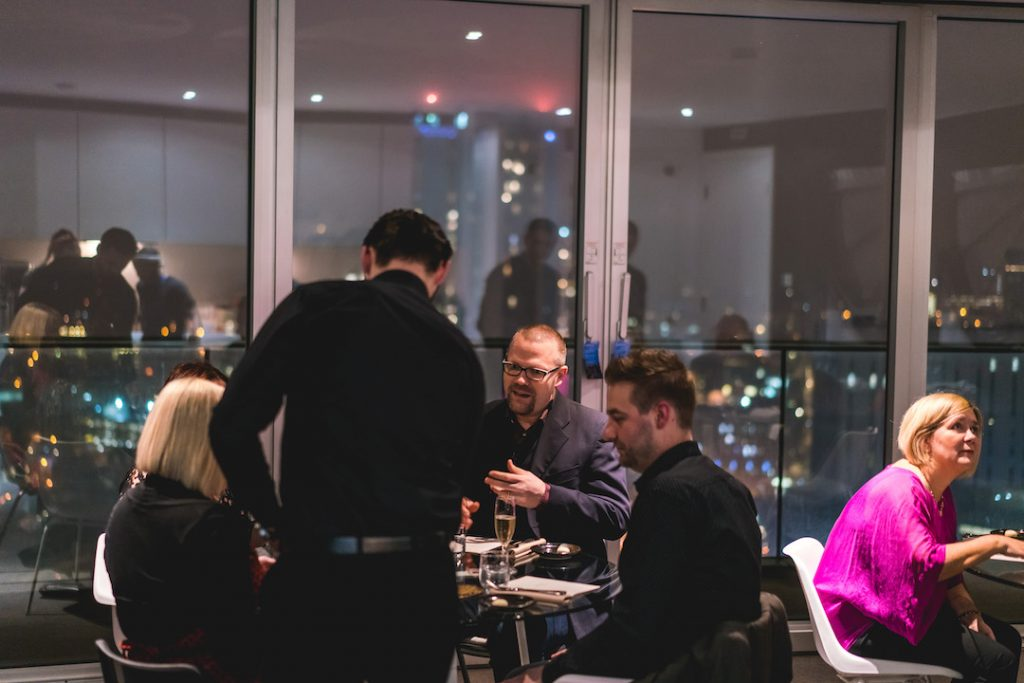 Guests Dining at Masterchef private dining event in a Staying Cool penthouse at Rotunda.jpg
