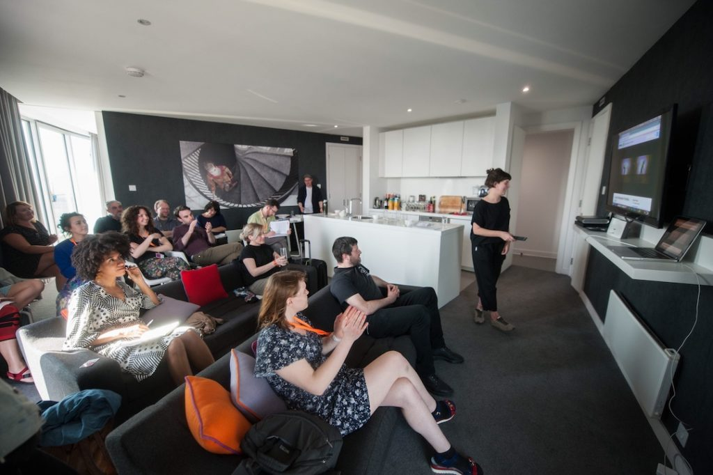 Presentation-to-audience-in-a-Staying-Cool-penthouse-at-Rotunda.-72px