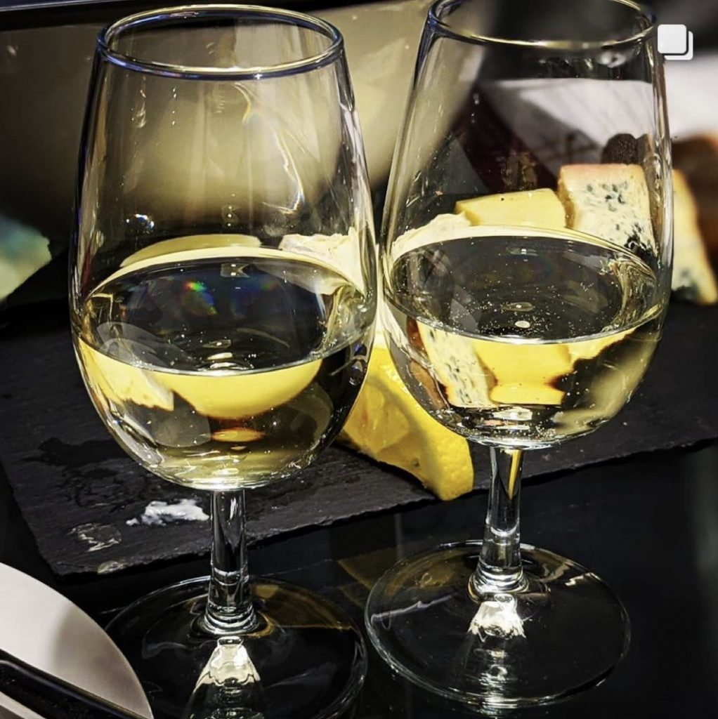Two glasses of white wine from the Wine Staycation event at Staying Cool's Rotunda Aparthotel