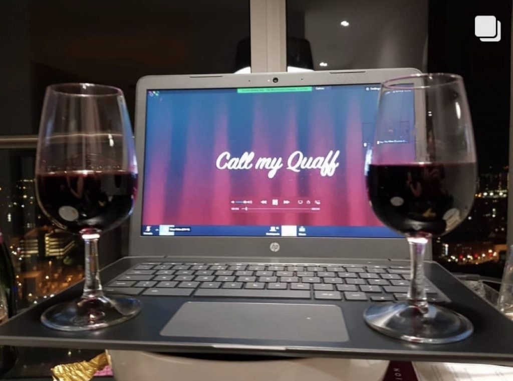 two glasses of red wine infront of the zoom call on screen at The Wine Staycation event at Staying Cool's Rotunda Aparthotel