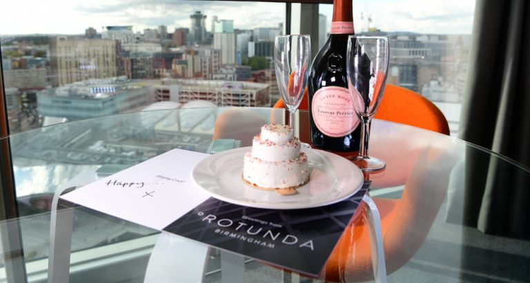 Staying Cool celebratory cake with Laurent Perrier Champagne with views of Birmingham from their Rotunda aparthotel