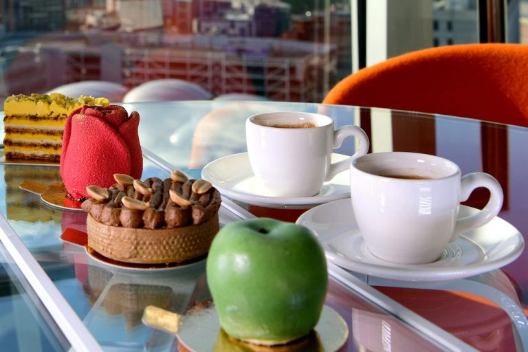 Freedom Fancies Cake selection accompanied by coffee with city views from staying cools apart hotel in Birmingham