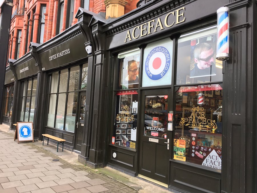 Exterior facade of the traditional Ace Face Barber shop in Birmingham city centre.