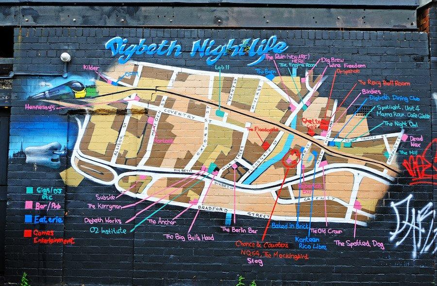 A map of Digbeth nightlife venues in Birmingham spray painted onto a  brick wall.