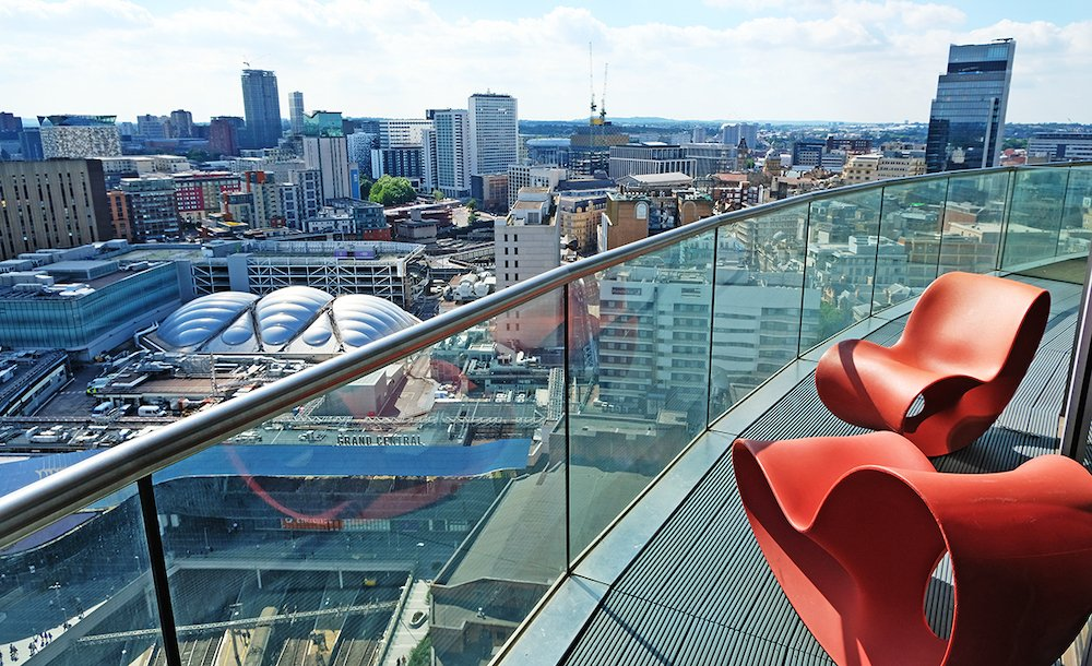 Blue skies and summer city views taken from Staying Cool's rotunda apart hotel penthouse balcony