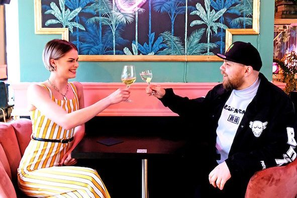 Two people enjoying drinks at The Pineapple Club in Birmingham, one of the many venues taking part in Birmingham Cocktail Weekend 2021