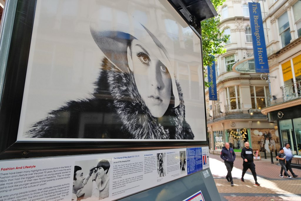 A photo of Twiggy exhibiting outside Staying Cool's Rotunda apart hotel on New Street Birmingham, part of the MirrorPix open-air photography exhibitition.